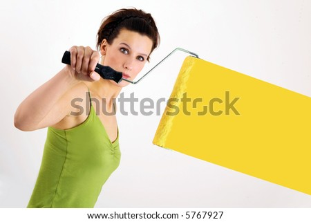 Woman painting on wall - stock photo