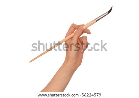 woman paints a picture with a brush - stock photo