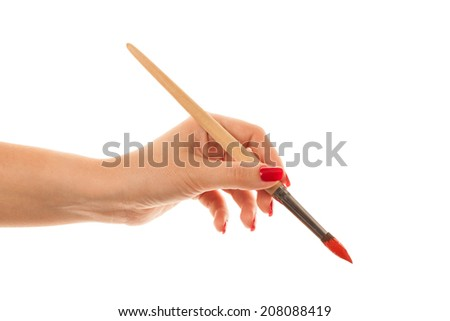 woman paints a picture with a red brush