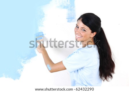 woman paints the wall