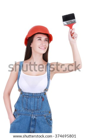 woman paints the wall brush - stock photo