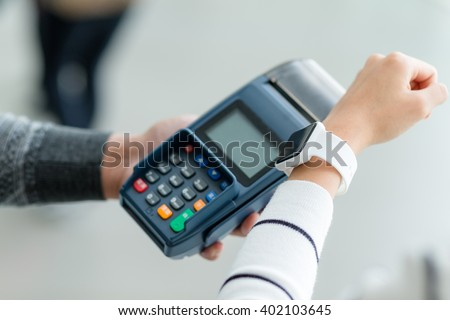 Woman pay by smart watch