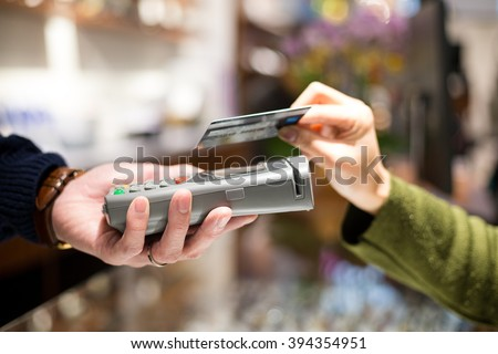 Woman pay with credit card by NFC - stock photo
