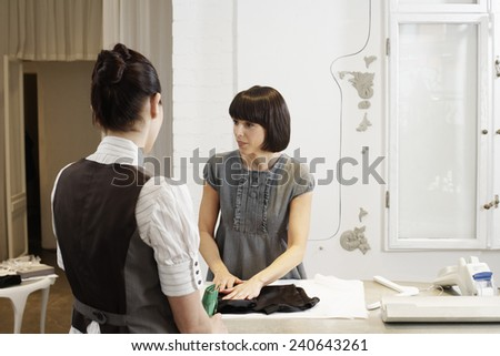 Woman Paying in Boutique - stock photo