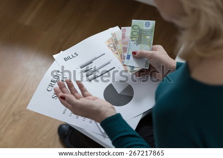 Woman paying off the loan analyzing her budget - stock photo