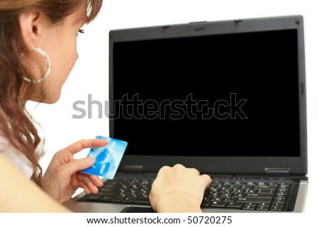 Woman pays credit card when buying products online - stock photo