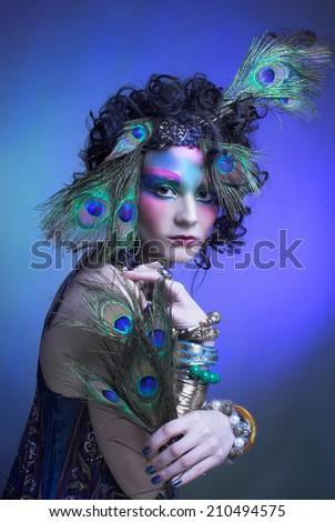 Woman - peacock/ Young lady in creative image. - stock photo