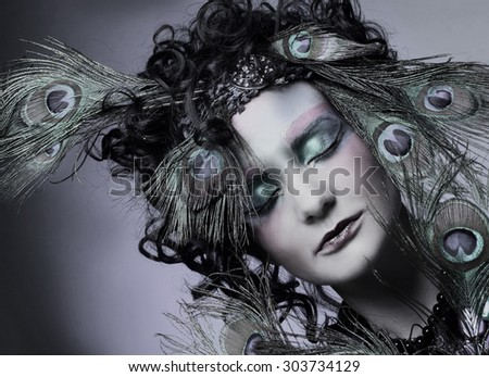 Woman - peacock/ Young lady in creative image.