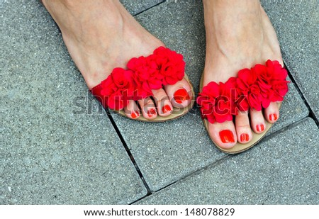 woman pedicured feet in summer style fashion sandals - stock photo