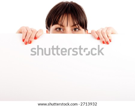 Woman peeping over white paper