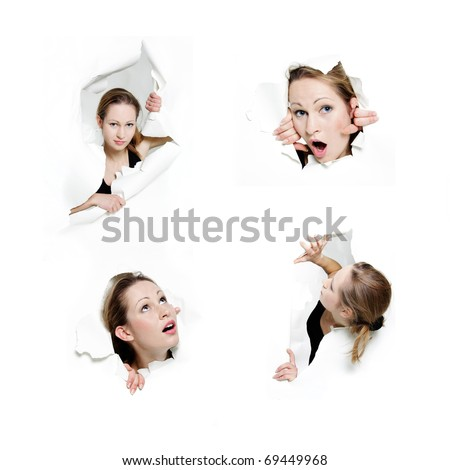 woman peeping through hole in paper - stock photo