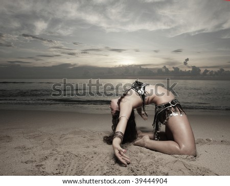 Woman performing a backwards bend - stock photo