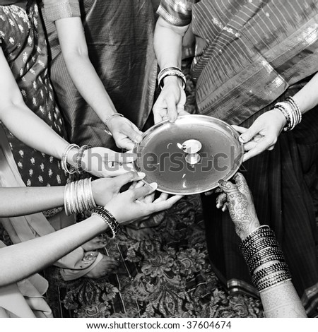 woman performing special rituals at a hindu wedding - stock photo