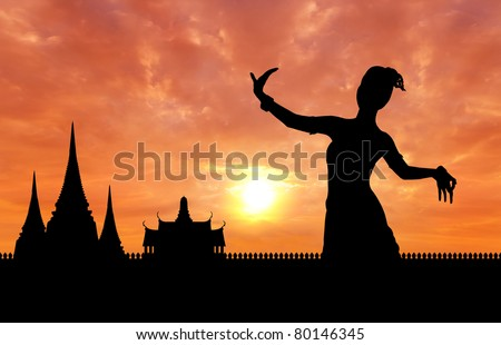 woman performing typical thai dance silhouetted with thai style temple background, identity culture of thailand - stock photo
