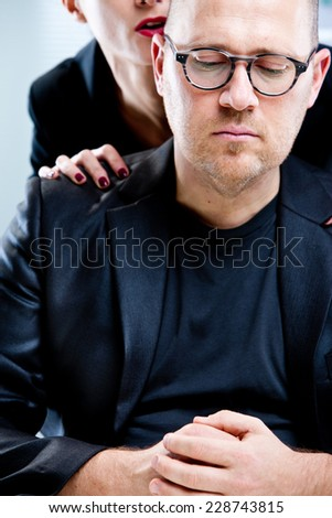 woman pestering a man in a workplace - stock photo