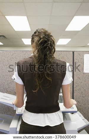 Woman Photocopying - stock photo