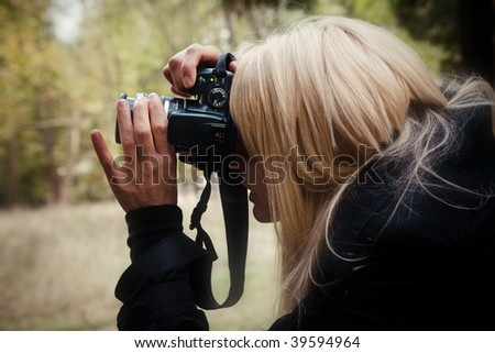 woman photographer in action outdoor - stock photo