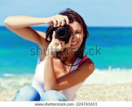 woman photographer on the beach - stock photo