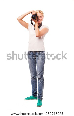 Woman photographer shooting, isolated on white background - stock photo