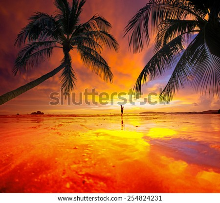 Woman photographer Sunset on the beach of Ao Nang in Krabi Thailand - stock photo