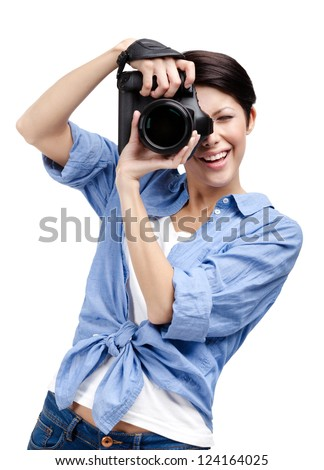 Woman-photographer takes images, isolated on white background - stock photo