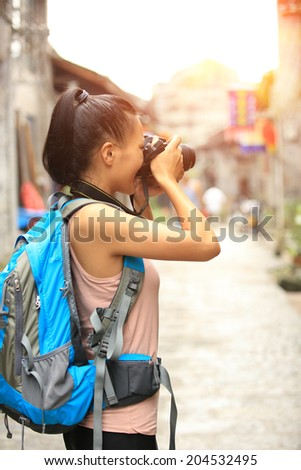 woman photographer taking photo in guilin,china