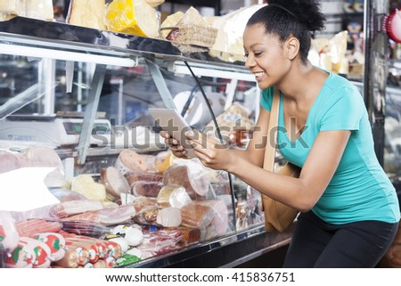 Woman Photographing Products Through Digital Tablet - stock photo