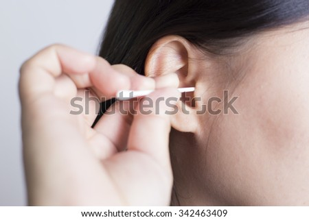 Woman Picking Her Ear