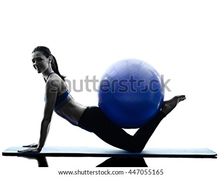 woman pilates ball exercises fitness isolated - stock photo