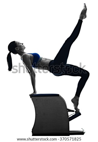 woman pilates chair exercises fitness isolated - stock photo
