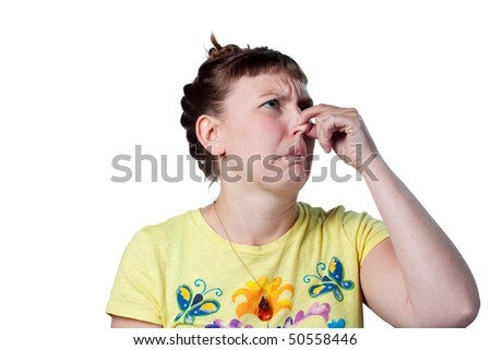 Woman pinches her nose, bad smells in the air - stock photo