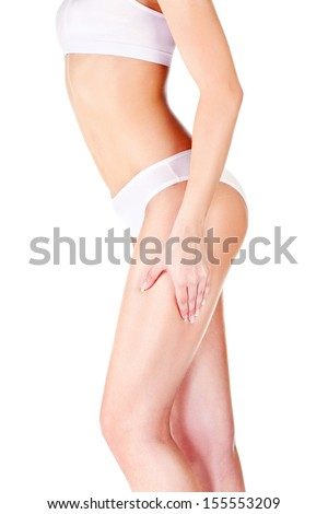 Woman pinching leg for skin fold test, isolated on white. Health concept  - stock photo