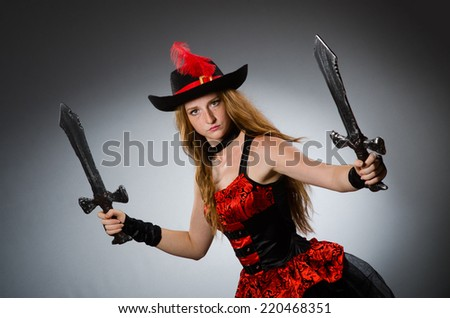Woman pirate with sharp weapon