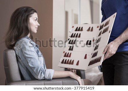 Woman planning to dye hair at the hairdresser's - stock photo