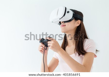 Woman play the video game with virtual reality device - stock photo