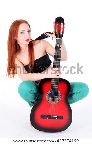 Woman play with red guitar