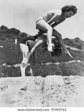 Woman playing at Beach - stock photo