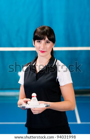 Woman playing Badminton and doing sport in gym - stock photo