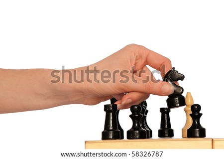 Woman playing chess and making black knights move - stock photo