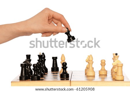 Woman playing chess and making black pawn move - stock photo