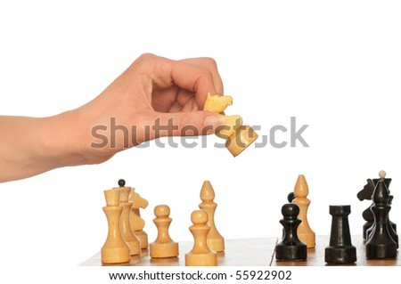 Woman playing chess and making white knights move - stock photo