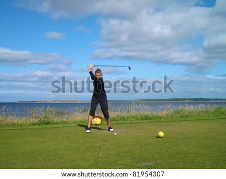 Woman playing golf on a beautiful links course in Northern Scotland