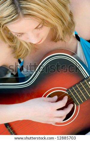 Woman Playing Guitar - stock photo