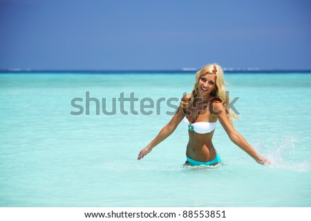 woman  playing in ocean water - stock photo