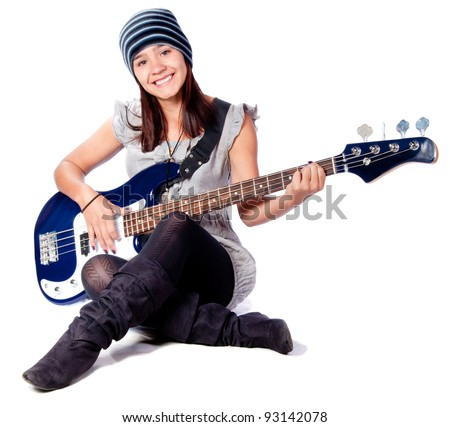 Woman playing music on an electric guitar - isolated over a white background