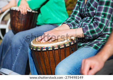 woman playing on Africa Jambe Drum  - stock photo