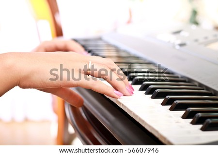 woman playing on electric piano - stock photo