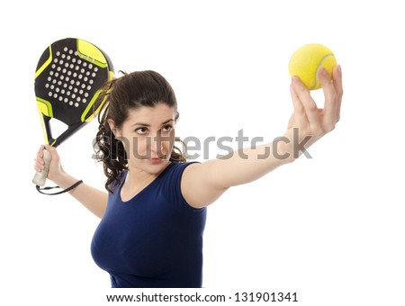 Woman playing paddle tennis. - stock photo
