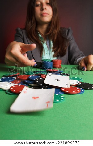 woman playing poker - stock photo