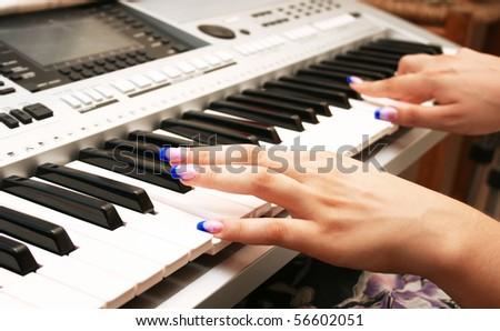 Woman playing professional keyboard. - stock photo
